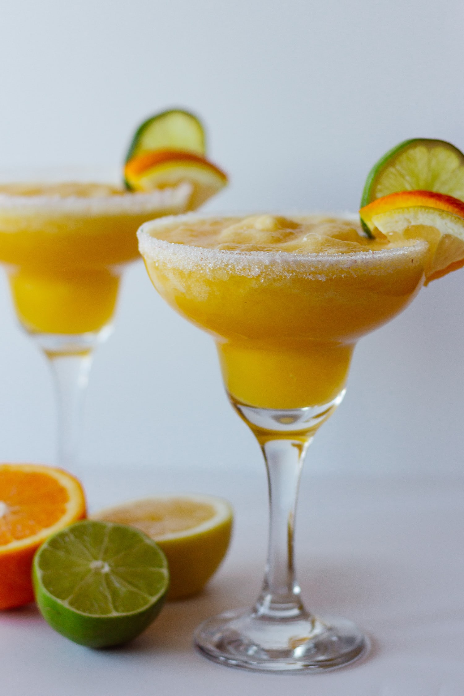 2 margarita glasses containing fresh citrus margarita