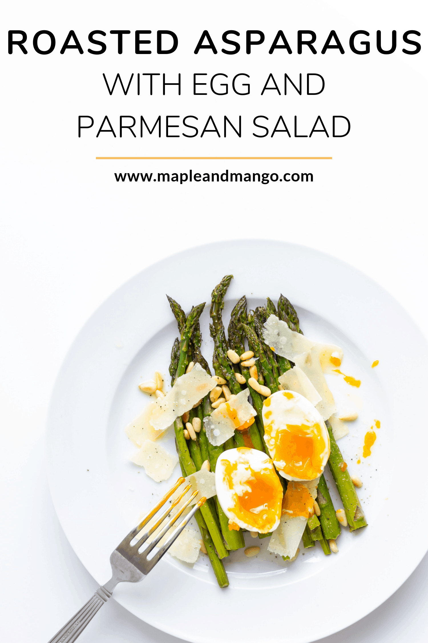 roasted asparagus on a white plate topped with soft boiled egg, parmesan shavings and toasted pine nuts