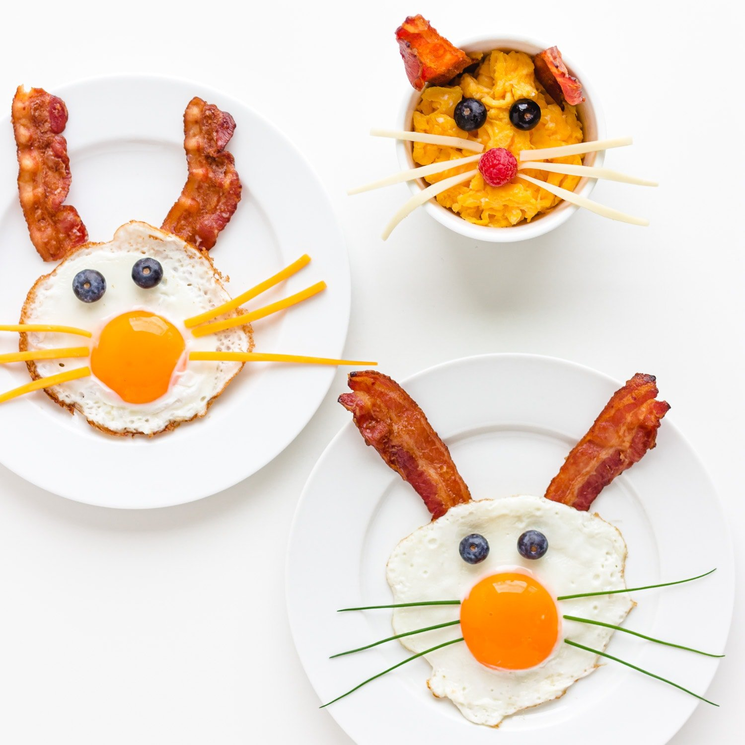 Three versions of bacon and egg bunnies using either fried eggs or scrambled eggs.