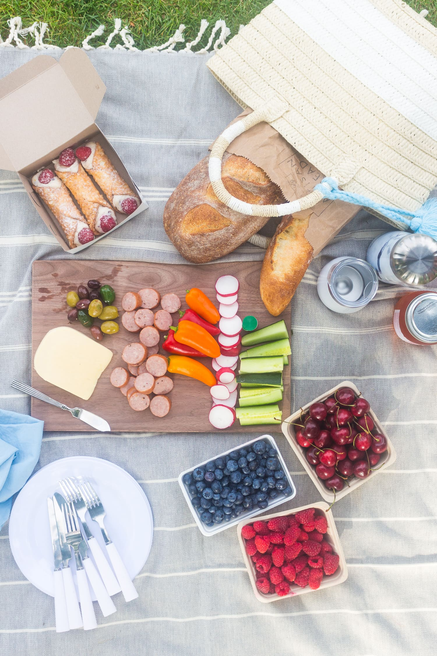 Overhead shot of a picnic set up on a blanket