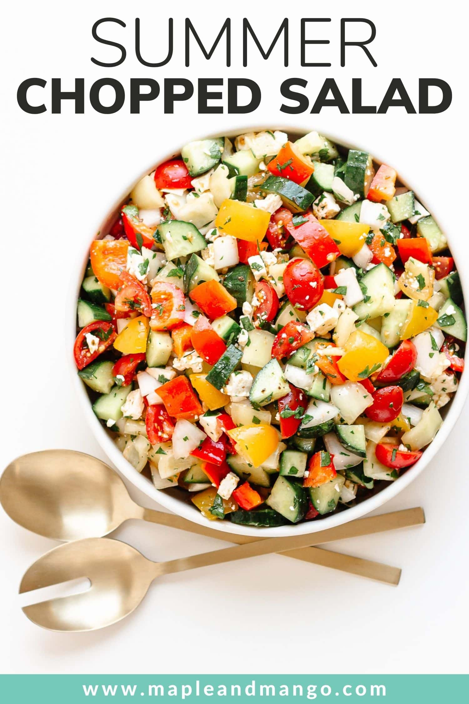 """Bowl of chopped salad with gold salad servers and text overlay """"Summer Chopped Salad""""."""