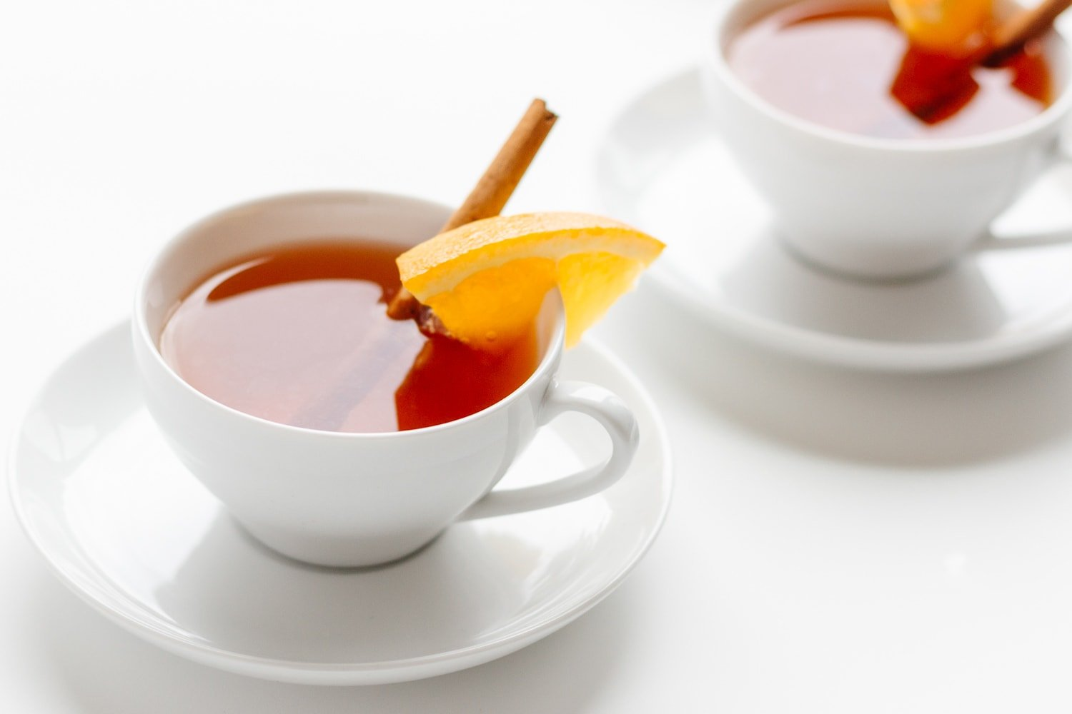 Two white tea cups filled with Orange |Spice Mulled Tea