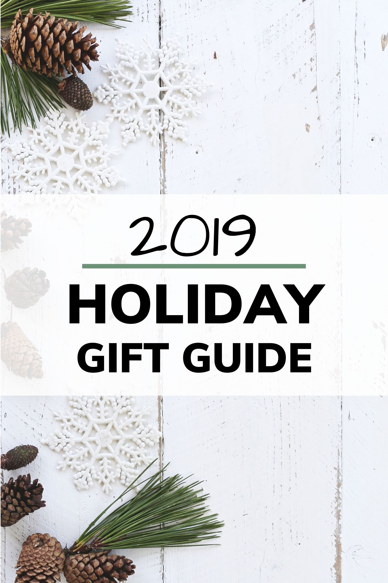Christmas decoration on white washed wood with text going across that says 2019 Holiday Gift Guide