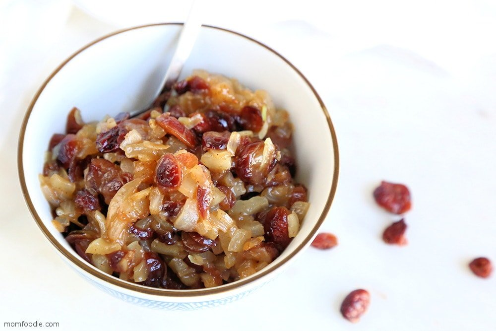 Cranberry Chutney in a bowl with spoon dipped in.