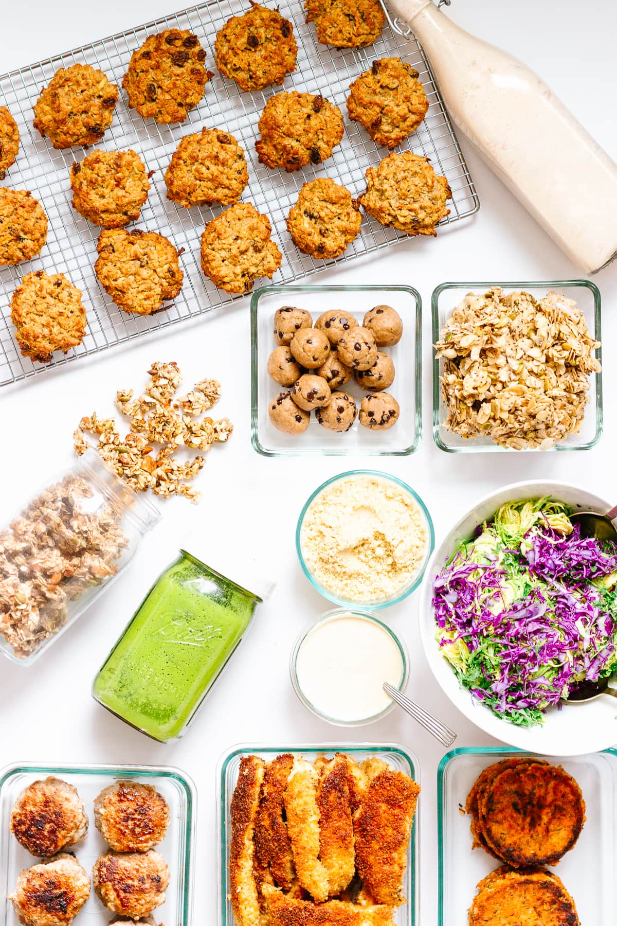 Top down photo of a variety of recipes meal prepped from The HealthNut Cookbook