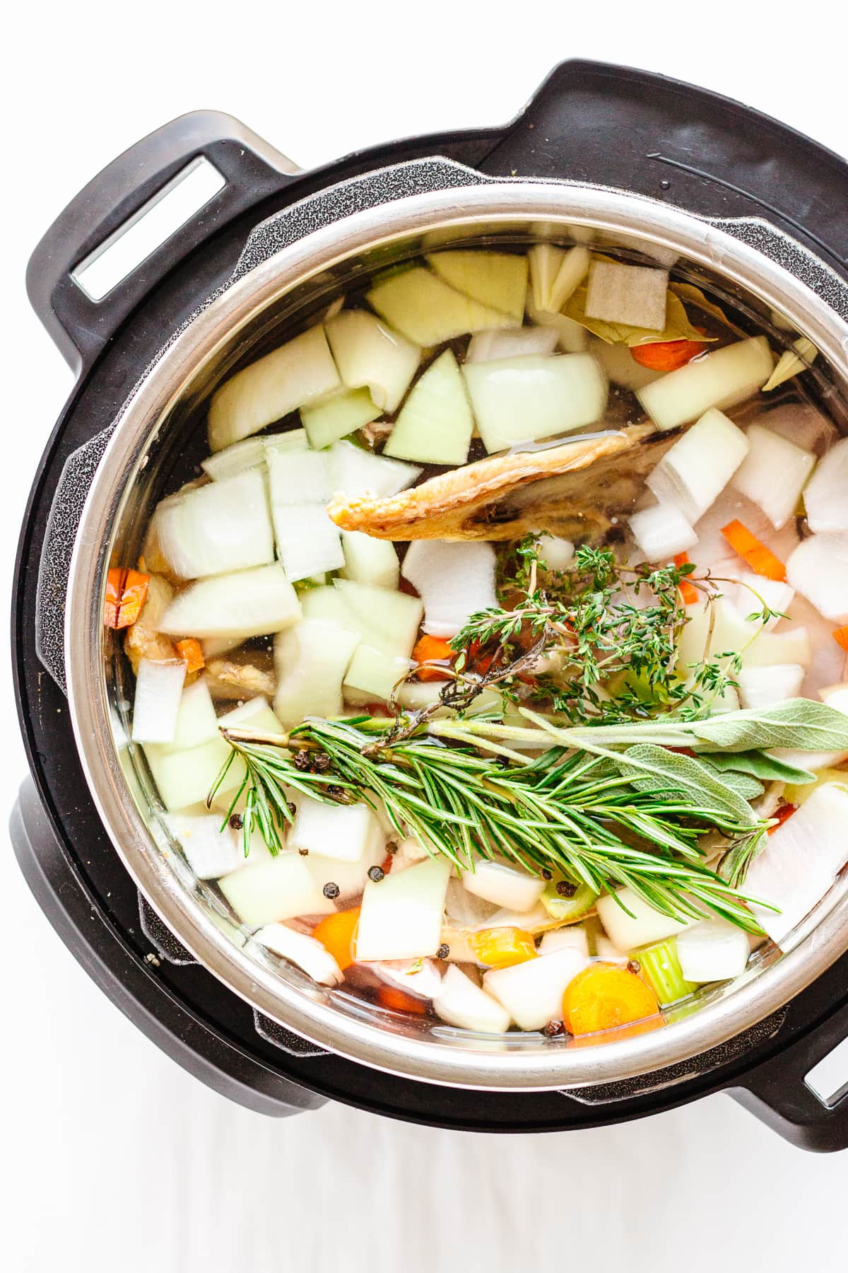 Overhead photo of chicken bone broth ingredients in the Instant Pot