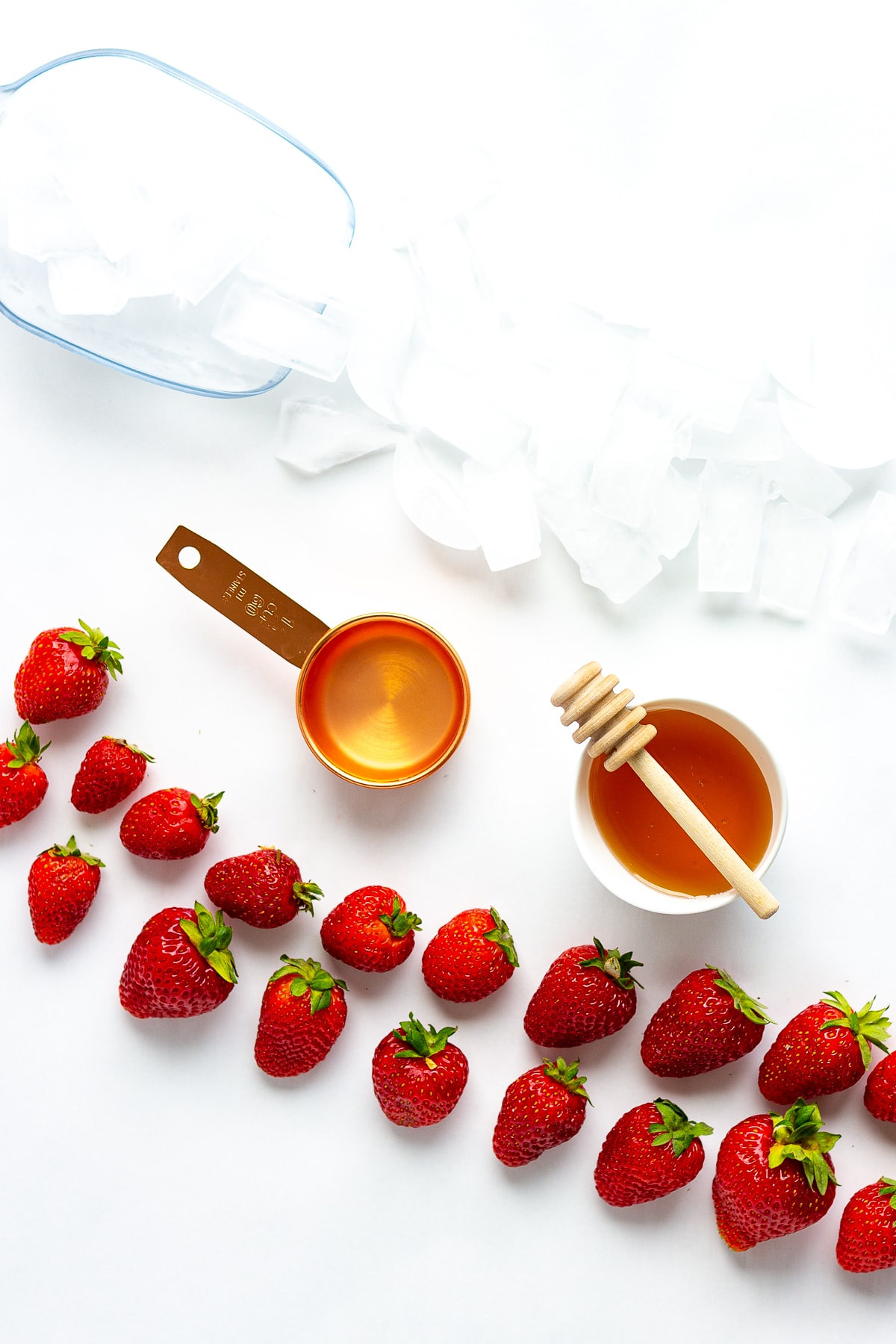Overhead photo of the ingredients needed to make a homemade strawberry slushie.