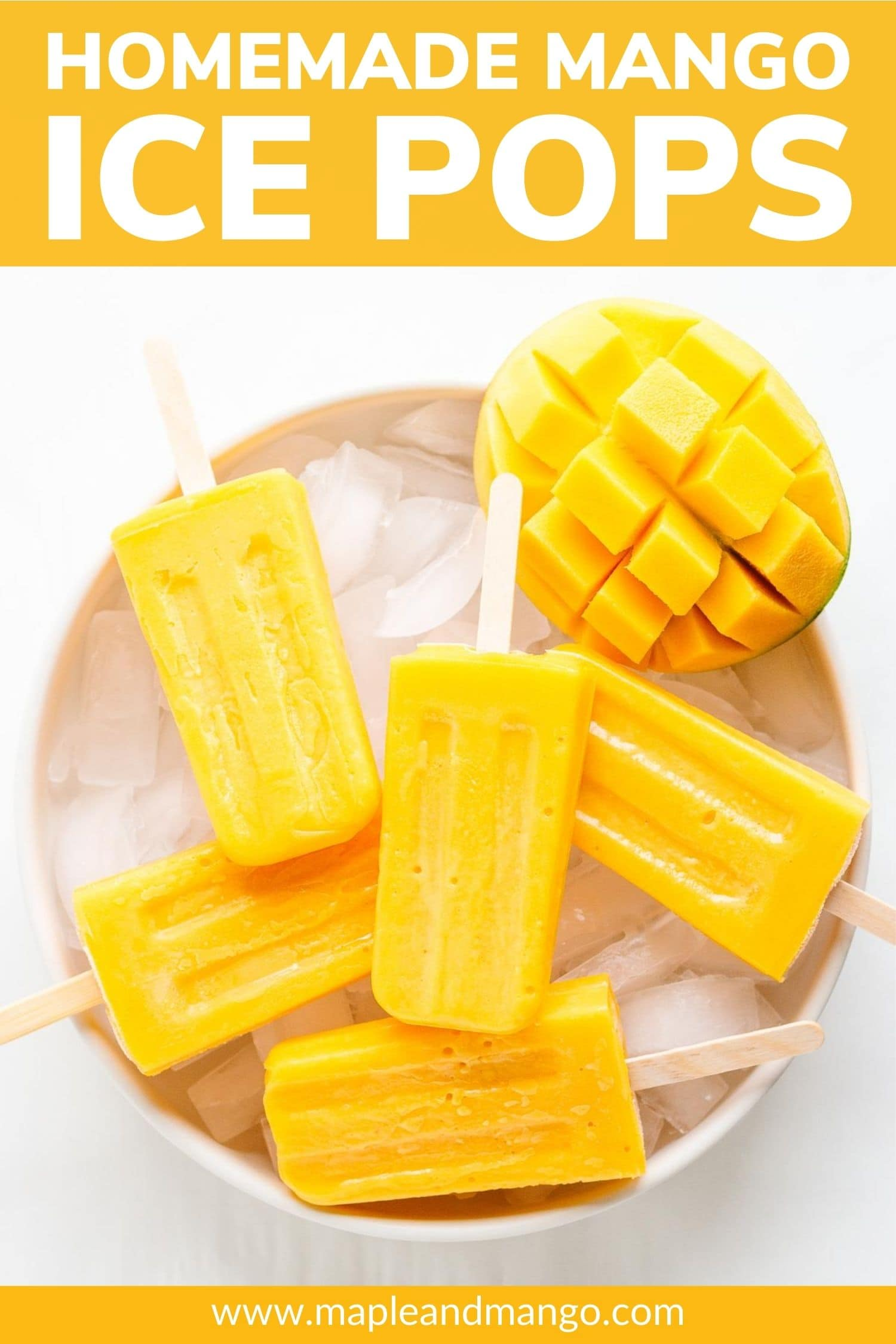 "Popsicles and half a mango sitting in a bowl of ice with text overlay ""Homemade Mango Ice Pops""."