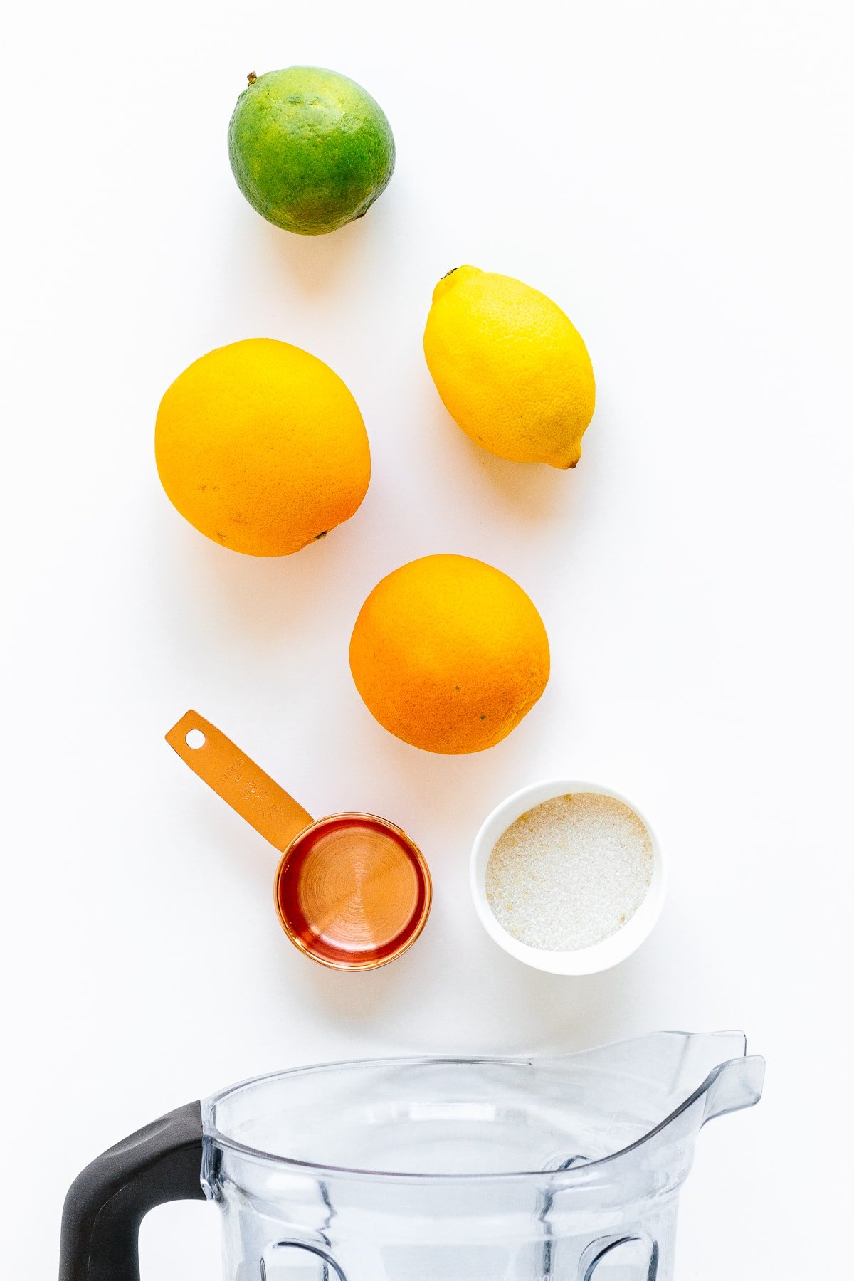 Overhead photo of ingredients needed to make orange lemon lime popsicles.