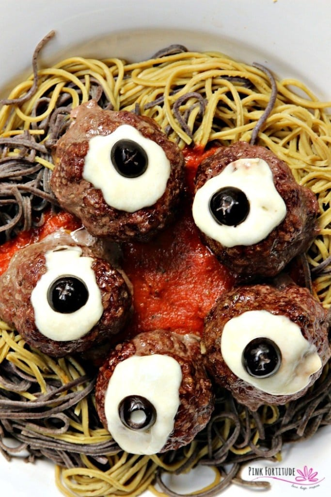 Plate of halloween themed spaghetti and meatballs.