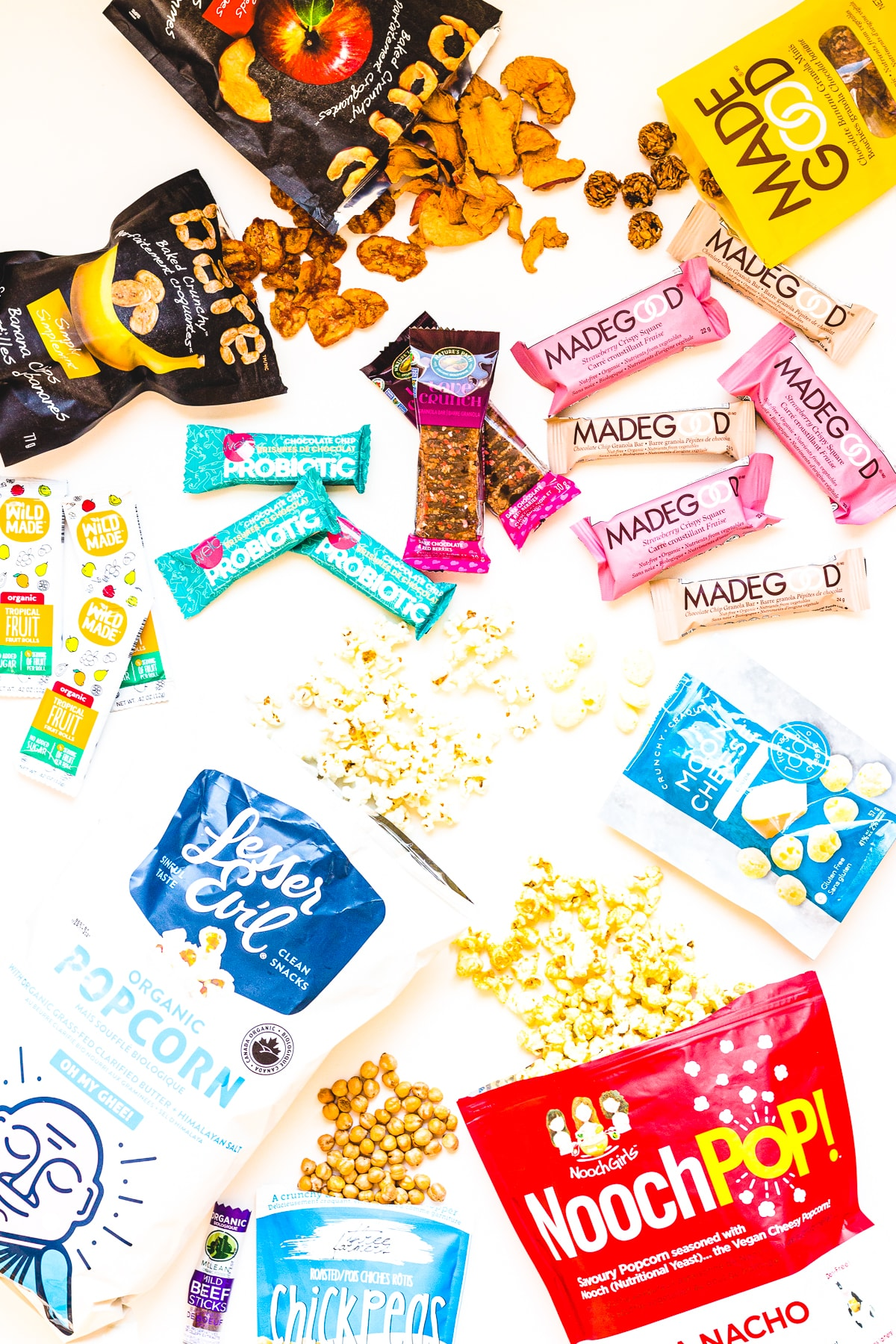 Overhead photo of a variety of healthy packaged snacks.