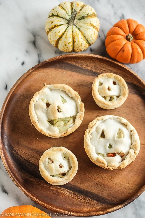 Jack O Lantern shaped chicken pot pies.