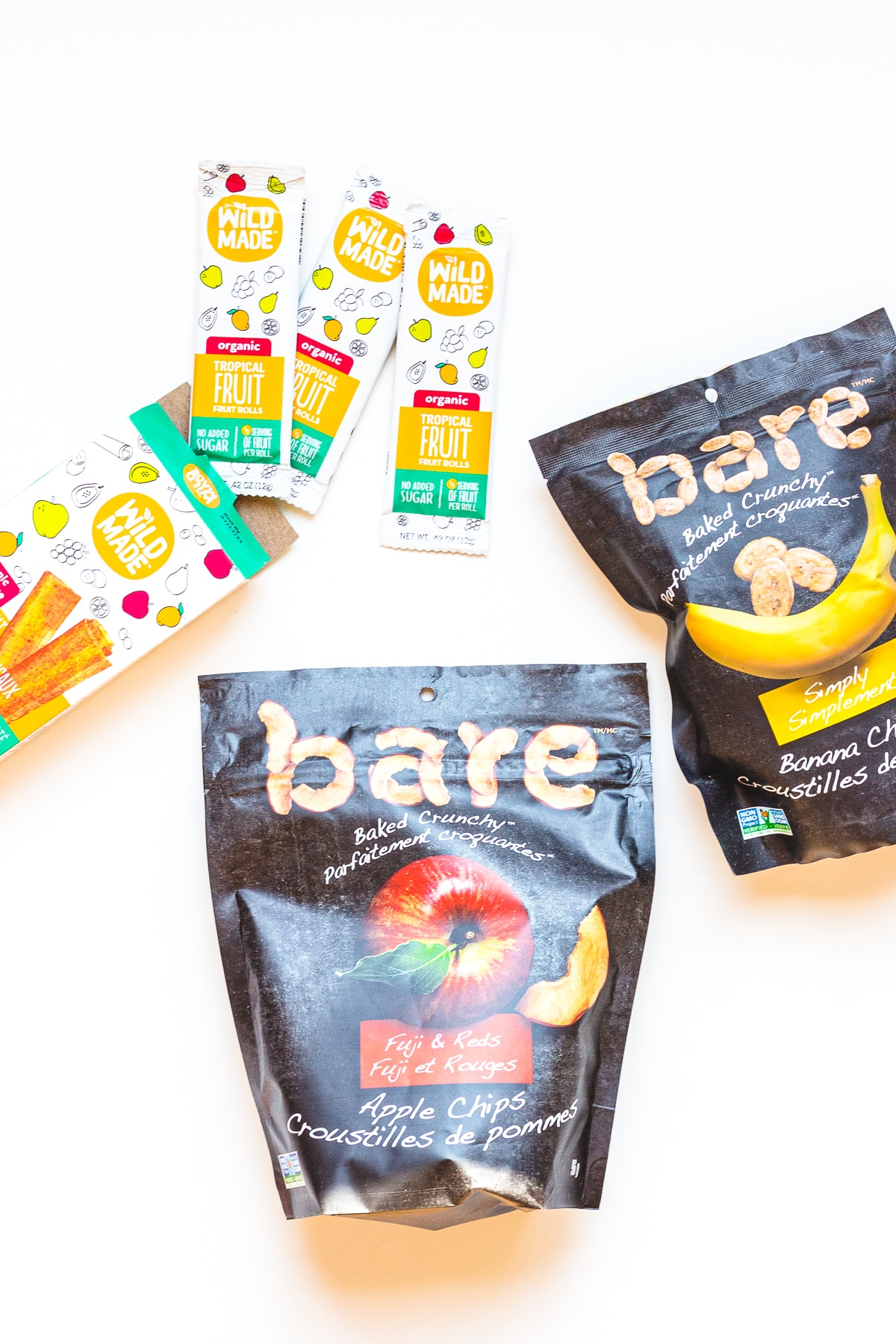 Variety of healthy packaged dried fruit snacks.