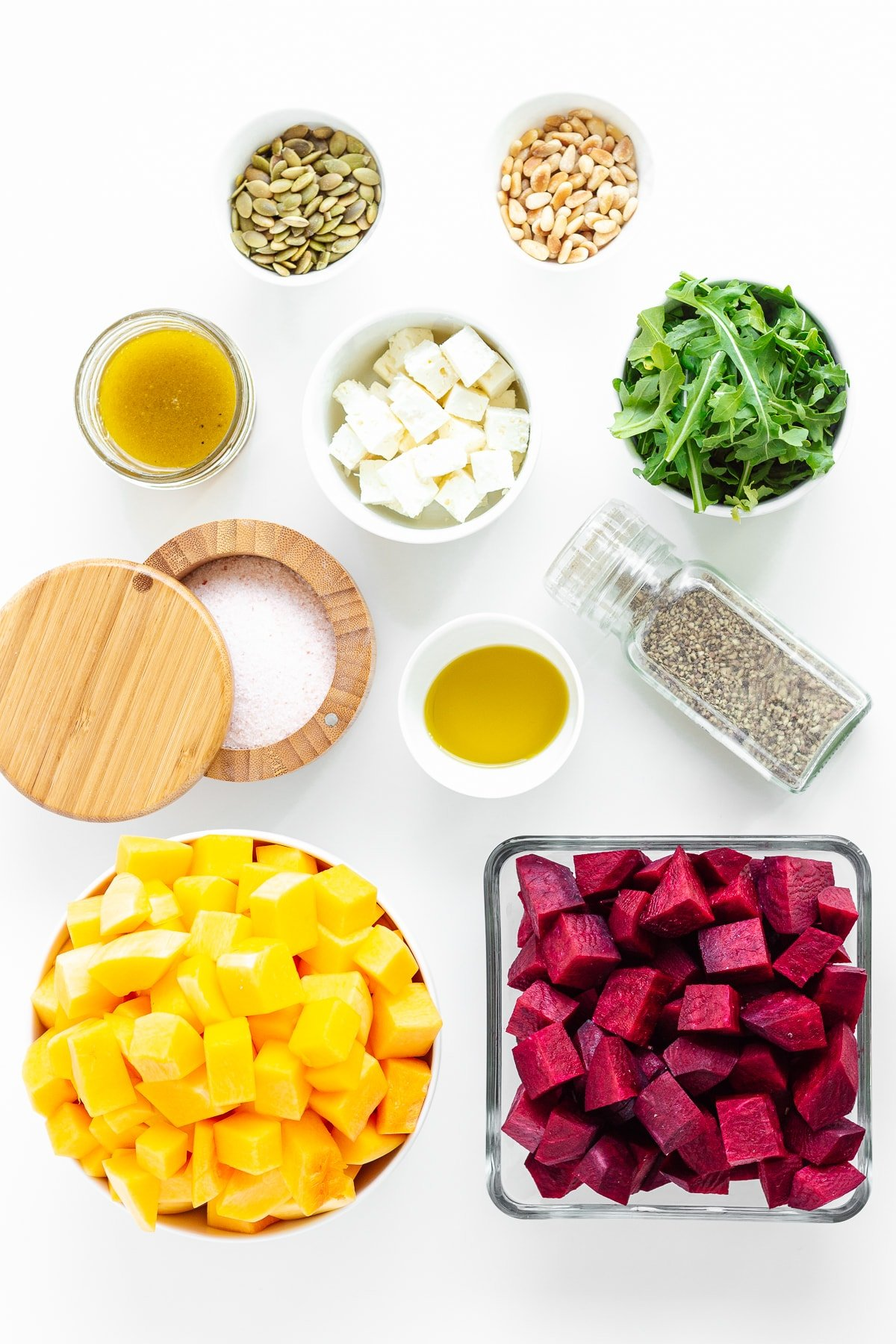 Overhead photo of ingredients needed to make a roasted pumpkin and beetroot salad.