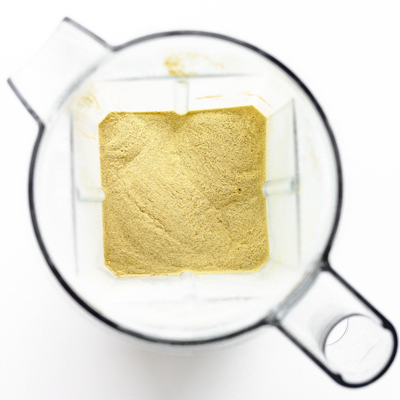 Blended bouillon powder seasoning in blender container.