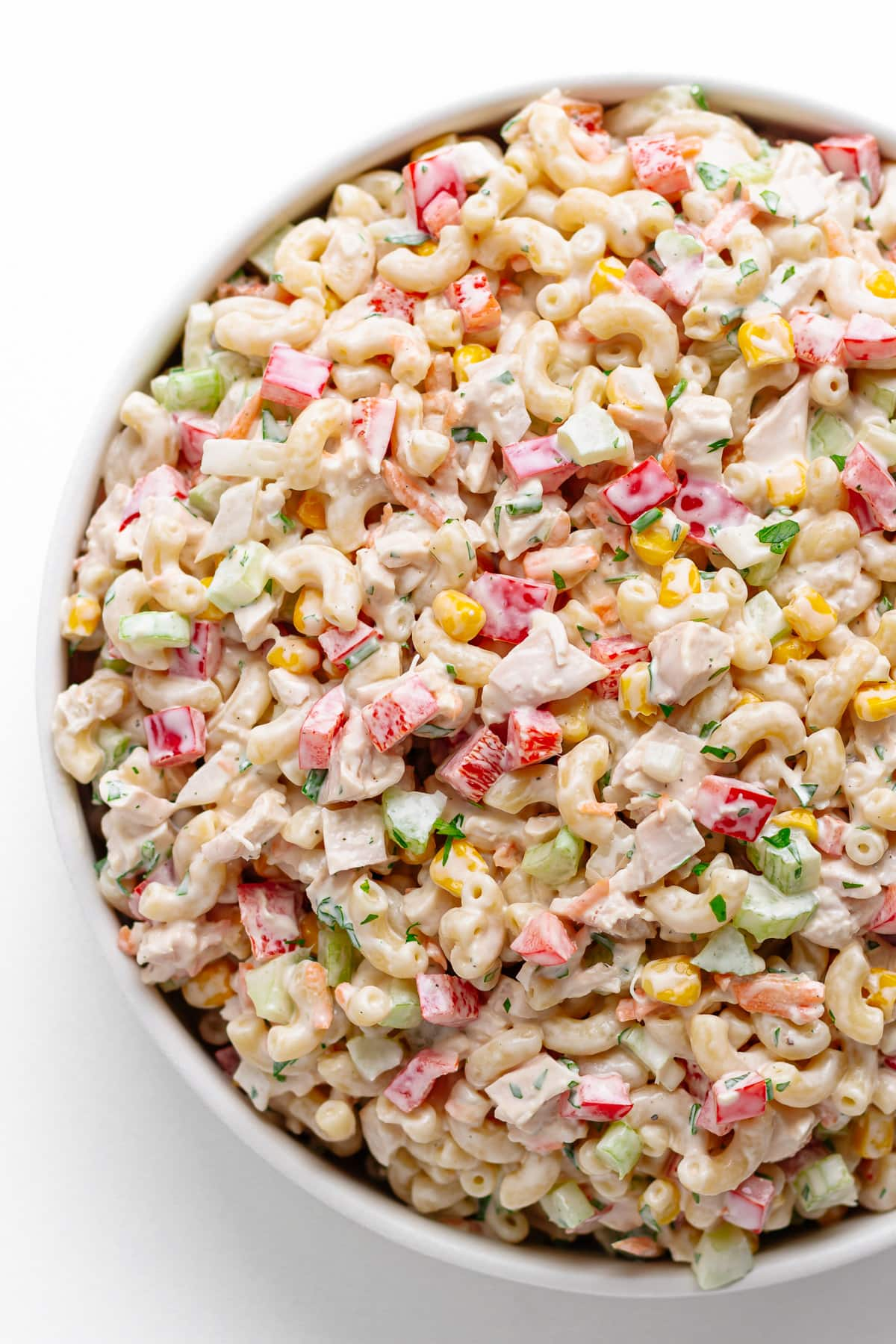 Chicken macaroni salad in a large shallow white serving bowl.